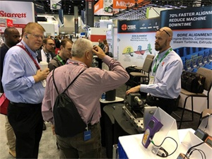 Rod Hamar talking with visitors about the new L-702SP Spindle Alignment Laser with Scan Plane