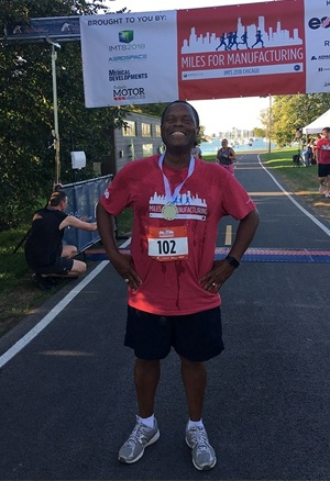 Ron Sullivan at the Miles for Manufacturing 5K finish line. His smile says it all!