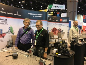 Jan Christianson of Flex-Cable (right) and Dan Cress of Andrews University (left) with the L-743 Ultra-Precision Triple ScanTM Laser, Hamar Laser's flagship alignment tool